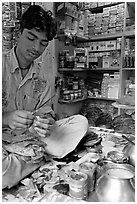 Street vendor preparing a snack with leaves. Mumbai, Maharashtra, India ( black and white)