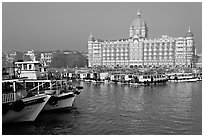 Tour boats and Taj Mahal Palace, morning. Mumbai, Maharashtra, India ( black and white)