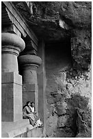 Women sitting at entrance of cave, Elephanta Island. Mumbai, Maharashtra, India ( black and white)
