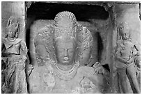 Trimurti flanked by pilasters with figures of dwarplalas, Elephanta caves. Mumbai, Maharashtra, India ( black and white)