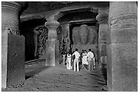 Vistors in main cave, Elephanta Island. Mumbai, Maharashtra, India (black and white)