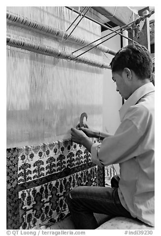 Man making a carpet. Agra, Uttar Pradesh, India (black and white)