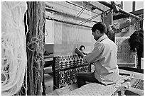 Man weaving a carpet. Agra, Uttar Pradesh, India (black and white)
