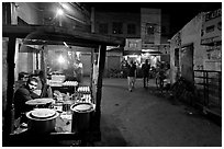 Food vendor and street by night, Taj Ganj. Agra, Uttar Pradesh, India (black and white)