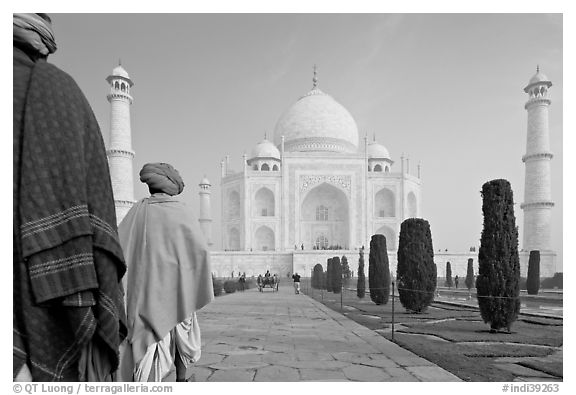 Men with turbans walking toward Taj Mahal, early morning. Agra, Uttar Pradesh, India