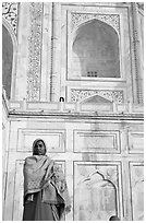 Woman standing at the base of Taj Mahal. Agra, Uttar Pradesh, India (black and white)