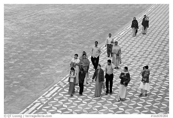 Families walking on decorated terrace, Taj Mahal. Agra, Uttar Pradesh, India (black and white)