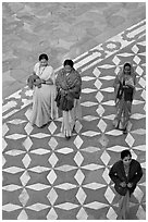 Women walking on decorated terrace, Taj Mahal. Agra, Uttar Pradesh, India (black and white)