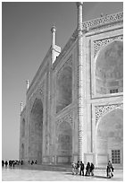 People strolling around main structure, Taj Mahal. Agra, Uttar Pradesh, India (black and white)