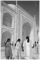 Women in colorful Shalwar suits, Taj Mahal. Agra, Uttar Pradesh, India (black and white)