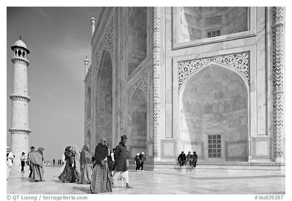 Base of Taj Mahal, minaret, and visitors. Agra, Uttar Pradesh, India