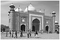 Taj Mahal masjid with people strolling. Agra, Uttar Pradesh, India (black and white)