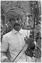 Musician with string instrument. Agra, Uttar Pradesh, India (black and white)