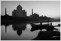 Boat on Yamuna River in front of Taj Mahal, sunset. Agra, Uttar Pradesh, India (black and white)