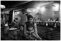 Children and food booth at night, Agra cantonment. Agra, Uttar Pradesh, India (black and white)