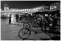 Cycle-rickshaws in front of train station. Agra, Uttar Pradesh, India ( black and white)