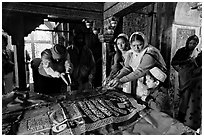 Women making offerings on Shaikh Salim Chishti tomb. Fatehpur Sikri, Uttar Pradesh, India (black and white)