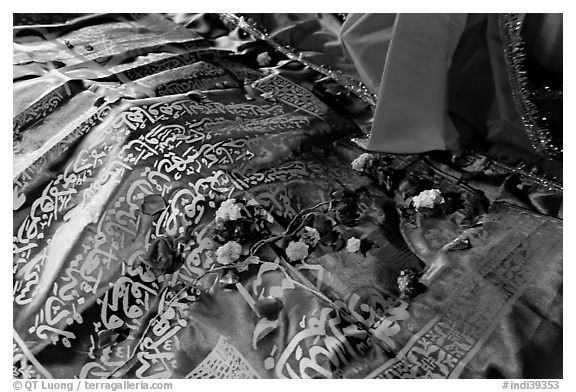 Cloth covering Shaikh Salim Chishti tomb with offered flowers. Fatehpur Sikri, Uttar Pradesh, India (black and white)