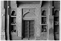 Wall with shoes stored, Dargah mosque. Fatehpur Sikri, Uttar Pradesh, India (black and white)