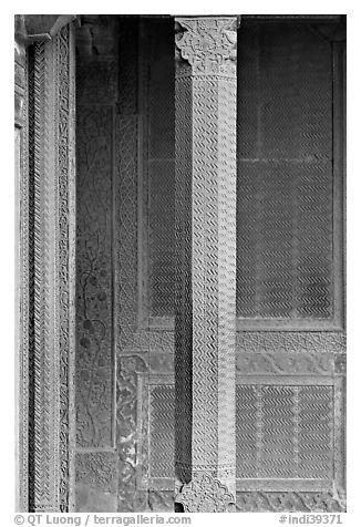 Carved columns and wall of the Rumi Sultana building. Fatehpur Sikri, Uttar Pradesh, India (black and white)
