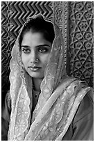 Young woman with embroided scarf, in front of Rumi Sultana wall. Fatehpur Sikri, Uttar Pradesh, India (black and white)