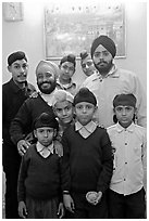 Sikh men and boys in front of picture of the Golden Temple. Bharatpur, Rajasthan, India (black and white)