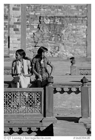Young women sitting in the center of Ornamental pool. Fatehpur Sikri, Uttar Pradesh, India (black and white)