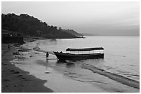 Narrow boat on beach at dawn, Dona Paula. Goa, India (black and white)