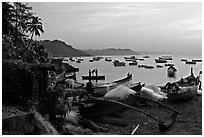 Fishing boats on beach, sunrise. Goa, India (black and white)