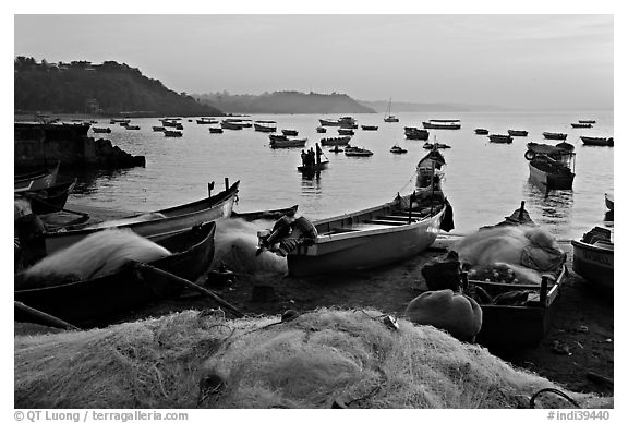Fishing nets and boats, sunrise. Goa, India (black and white)