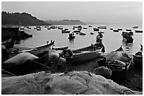 Fishing nets and boats, sunrise. Goa, India ( black and white)