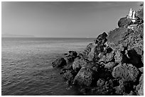 Boulders and christian statues at the edge of ocean, Dona Paula. Goa, India (black and white)
