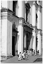 People at the entrance of Se Cathedral, Old Goa. Goa, India ( black and white)