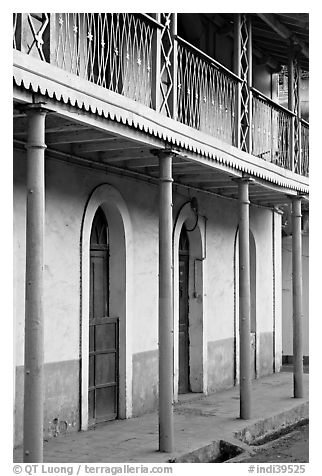 House with balconies painted green, Panjim. Goa, India (black and white)