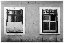 Windows on facade painted blue, Panjim. Goa, India (black and white)
