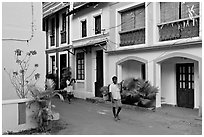 Men returning from work with tools, Panjim. Goa, India (black and white)