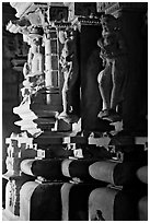 Statues in the corridor (pradakshina), Parsvanatha temple, Eastern Group. Khajuraho, Madhya Pradesh, India (black and white)