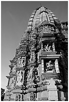 Bands of carved sculptures below spire (sikhara), Javari Temple, Eastern Group. Khajuraho, Madhya Pradesh, India ( black and white)
