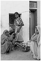 Women cooking outside in village. Khajuraho, Madhya Pradesh, India ( black and white)