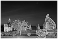 Temples of the Western Group at night. Khajuraho, Madhya Pradesh, India (black and white)