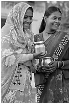Women with pots used for religious offerings. Khajuraho, Madhya Pradesh, India ( black and white)