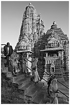 Worshipers going down stairs in front of Lakshmana temple. Khajuraho, Madhya Pradesh, India (black and white)