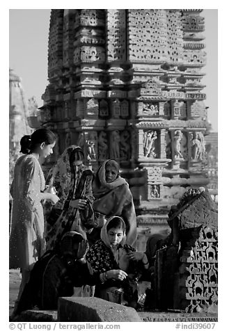 Women offering morning puja  in front temple spire. Khajuraho, Madhya Pradesh, India (black and white)