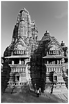 Lakshmana temple seen from Matangesvara temple, with people looking. Khajuraho, Madhya Pradesh, India ( black and white)