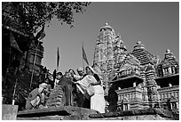 Worshippers making offering at Matangesvara temple with  Lakshmana behind. Khajuraho, Madhya Pradesh, India (black and white)