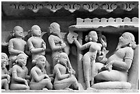 Sculpture of royal court scene, Lakshmana temple. Khajuraho, Madhya Pradesh, India (black and white)