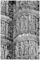 Sculptural details with apsaras, Kadariya-Mahadev temple. Khajuraho, Madhya Pradesh, India (black and white)
