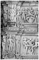 Apsaras and mithunas, Kadariya-Mahadeva temple. Khajuraho, Madhya Pradesh, India (black and white)