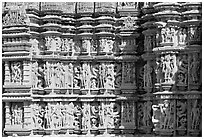 Sculptures on the outside of Kadariya-Mahadeva temple. Khajuraho, Madhya Pradesh, India (black and white)