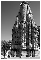 Women walking at the base of the sikhara of Devi Jagadamba temple. Khajuraho, Madhya Pradesh, India ( black and white)